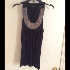 Cute black top Cut black top with beaded neckline. Loose fitting around mid section very flattering new never worn Tops