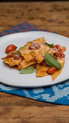 Sautéed tomatoes and garlic are the perfect compliments to this simple hand-torn pasta dish.