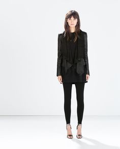 This whole outfit is amazing. Image 1 of LEATHER JACKET WITH POINTED HEM from Zara