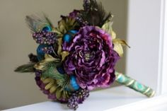 Yes, B, yes! Give or take the peacock feathers. Exchange the green for cream flowers with eggplant/navy.