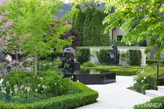 Sculpture-Filled Gardens: When the house was finished, the Bradshaws--the owners of this home--gave a party to thank everyone who had contributed to the project - Artful Toronto Home