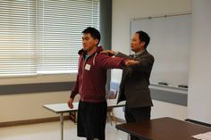 Dr. Eng demonstrating with a student.
