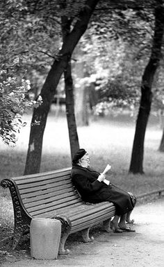 old lady reading newspaper in Moscow 1973