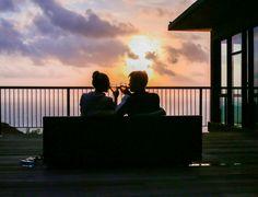 couple toasting at sunset
