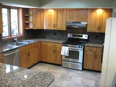Same color cabinets as now, but shaker style!