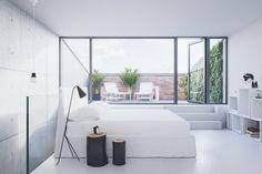 Minimalistinen makuuhuone.