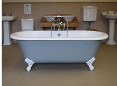 Roll top bath painted in Farrow & Ball Pigeon