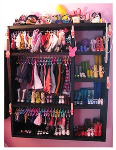 This looks like a bookshelf! Very clever!    Makes me think we shoudl clean out a sheft and turn it into a doll house for her new AG doll.  Maybe I could convince her to get rid of the barbie stuff!