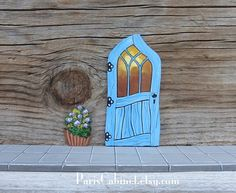 Hey, I found this really awesome Etsy listing at https://www.etsy.com/listing/192074705/blue-crooked-fairy-door-tooth-fairy-door