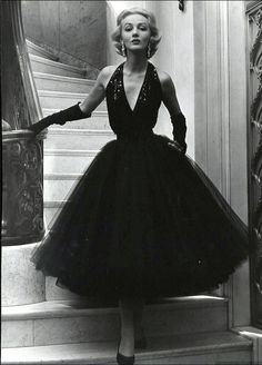 1948 Short evening dress with sequined halter top and yards of tulle for the bouffant skirt by Traina-Norell, photo by Nina Leen