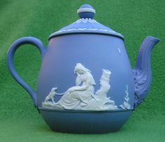 Wedgwood tea for one teapot c.1785. White basrelief scenes on a light blue  background. height 11 cm, diam. 8 cm.