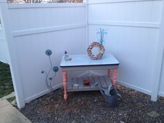 Outside planting table made from repurposed materials with a vintage porcelain top.  Checkout Knot your usual furniture at https://m.facebook.com/profile.php?id=238525842988129