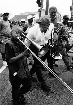 Playing Leona Blazio's jazz funeral, Rampart Street, New Orleans, Louisiana, March, 1994.capture the second line.  Eddie Boh Paris is the older trombonist. by Ed Newman