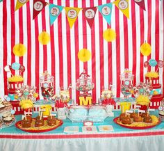 "Elements of this candy buffet design that I love:  circus font used on the bunting, ""M"" tucked in the middle, hat boxes to height and color, red/white striped cupcake wrappers, glassine bags with favor tags/stickers (do 2 different designs)."