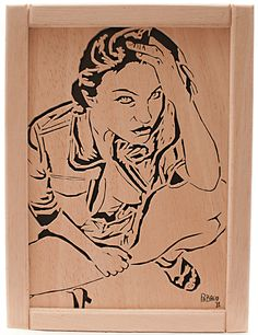 Scroll Saw Portrait, did this pattern from a pic that I found in the net. Work made in plywood whit a scroll saw.