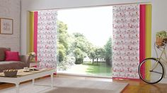 Panel blind is the most innovative shading solution for larger windows and patio doors. This blind also looks stunning as a stylish room divider. Here in yellow, pink with bicycle pattern.  Bolton Blind's panel blind is available in a diverse range of designs and fabrics including, sheer voiles and faux suede, all of which will enhance the decor of any room.