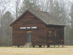 While driving north on I-85, right after exit 90, there's an old wooden schoolhouse, Possum Trot school, seen along the frontage road. There's a cache hidden in the woods behind the school. GC1HC4M