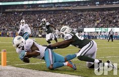 New York Jets David Harris defends Miami Dolphins Dion Sims who gets his knee inbounds and after an instant replay review the play is…