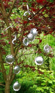 art with metal pop cans   Garden ornaments from recycled pop cans