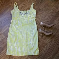 Yellow dress Beautiful yellow dress with gray silver and white circles,  in great condition. Fabric has some stretch to it. Calvin Klein Dresses