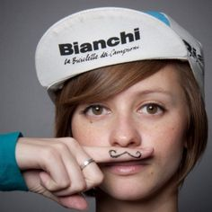 Bianchi cycling hat, short hair, and a funny mustache.  This remind you of anyone?