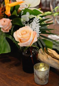 Wedding centerpiece ideas - roses, orange, greenery, pink, candles, bird of paradise {McLaughlin Photo & Video}