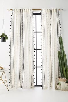 Beautiful curtains for a light and airy minimalist aesthetic. I love the black and white pattern and the tassels add a lovely #bohemian vibe #affiliate #anthropologie #curtains #minimalistdesign #scandinaviandesign
