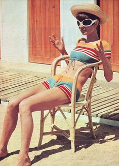 "The actress Audrey Hepburn photographed by Pierluigi Praturlon in Saint-Tropez (France), during a break in the filming of her new movie ""Two for the Road"", in July 1966. Audrey was wearing: • Two-piece for the beach: Miss Dior (of a knitted fabric..."