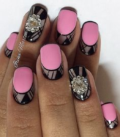 Beautiful black, gray and pink inspired nail art design for the summer. It looks vibrant, bold and ready to party. Apart from the checked designs and the plain pink colors in the middle, e=impressive embellishments are also added on top for effect.