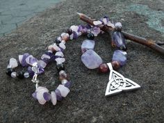 Check out this item in my Etsy shop https://www.etsy.com/listing/218675481/amethyst-tourmaline-triquerta-necklace