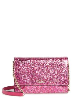 Pink glitter illuminates this fabulous Kate Spade bag that that offers signature-sophistication and look-at-me shine.