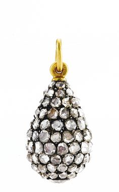 A FABERGÉ JEWELED EGG PENDANT, WORKMASTER MICHAEL PERCHIN, ST. PETERSBURG, CIRCA 1890. set with diamonds, the base with a larger collet-set diamond, struck with workmaster's initials, 56 standard, height (including suspension ring) 7/8 in. (2.2 cm)
