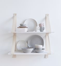 Pentik is an international interior design retailer, who wants to bring northern beauty and cosiness to homes. Grey And White, Pink Grey, Plates And Bowls, Ladder Bookcase, Shelves, Ceramics, Interior Design, Tableware, Strength