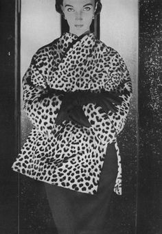 Harper's Bazaar, September 1953  Evelyn Tripp wearing a Leopard coat, sharply tailored to look like a Chinese jacket, by Reiss and Fabrizio.