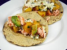 #fishtacos Salmon Tacos with slaw & mango salsa. These are even more amazing than they sound;.the flavors blend together really well.