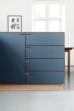 The surfaces are coated with a classic dark blue linoleum, whereas counter, drawers and details are made from solid oak. #forboforfurniture