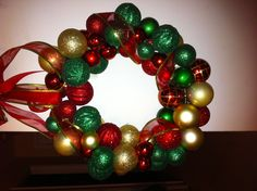 DIY Dollar Tree Ornament Wreath I made  Total cost: 6 dollars! Oh yeah!