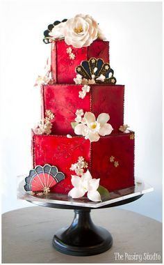 Cake Design by The Pastry Studio, Custom Cake features a rich red fondant base, sugar-paste florals, fans & piping touched with edible gold. Gorgeous Cakes, Pretty Cakes, Amazing Cakes, Unique Cakes, Creative Cakes, Wedding Cake Stands, Wedding Cakes, Chinese Cake, Asian Cake