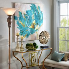 The Turquoise and Gold Flower Canvas Art Print is a perfect way to make a bold statement with metallics, while also staying on trend! It features trendy brushstrokes and bold colors that will make your home even more stylish.