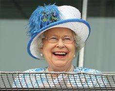 Queen Elizabeth II Photos - Queen Elizabeth II laughs as she watches the racing at Epsom Racecourse on June 4, 2016 in Epsom, England. - Epsom Races