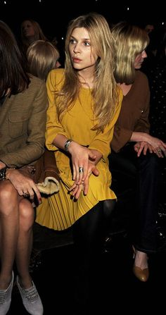 Clemence Poesy in mustard. (Think that's Kirsten Dunst to her left)