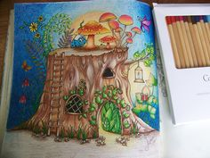"""From the """"Enchanted Forest"""" Johanna Basford Adult Coloring book. Tree Truck and Mushrooms. Colored by Donna Leger (added a Smurf)"""