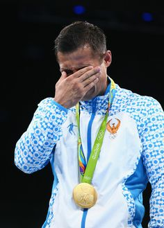 Gold medalist Fazliddin Gaibnazarov of Uzbekistan poses on the podium during the medal ceremony for the Men's Boxing Light Welter (64kg) on Day 16 of the Rio 2016 Olympic Games at Riocentro - Pavilion 6 on August 21, 2016 in Rio de Janeiro, Brazil.
