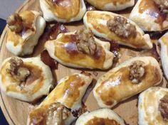 Receta de cocina Fácil y Original de Saquitos rellenos de queso de Cabra y Cebolla caramelizada.