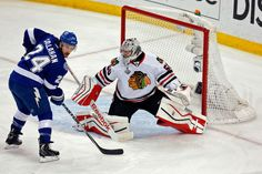 TAMPA, FL - JUNE 13: Corey Crawford #50 of the Chicago Blackhawks tends goal against Ryan Callahan #24 of the Tampa Bay Lightning during Game Five of the 2015 NHL Stanley Cup Final at Amalie Arena on June 13, 2015 in Tampa, Florida. (Photo by Mike Carlson/Getty Images)