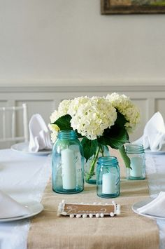 Burlap table runners - mason jars with white hydrageas.