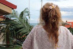Plumeria in her hair...