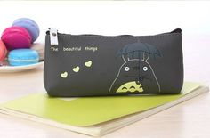 The soft but squishy TOTORO Pencil Pouch is light-weight and perfect for TOTORO lovers! The collection of TOTORO faces and the detail on this pouch are amazing. This is a medium capacity pouch that is