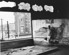 Boy in burnt out furniture store, Newark, 1969(Photo by Arthur Tress) The Amazing Arthur Tress Shares His Dark, Surreal Photographs From The 1970s: Gothamist