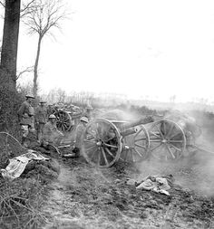 WWI, 13 April 1918; Operation Georgette. Gun crew of a Royal Field Artillery 18-pounder battery prepare to open fire near Meteren during the fighting for Hazebrouck. The nearest gun has just fired and is seen at recoil. Cropped. © IWM (Q 8713)